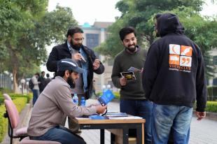 A busy dawah stall at a university